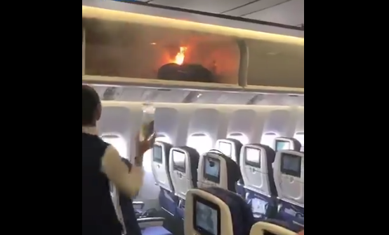 Terror on board flight as fire breaks out in overhead luggage hold